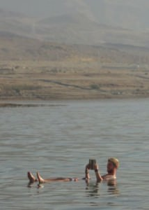 Reading a book in the Dead Sea