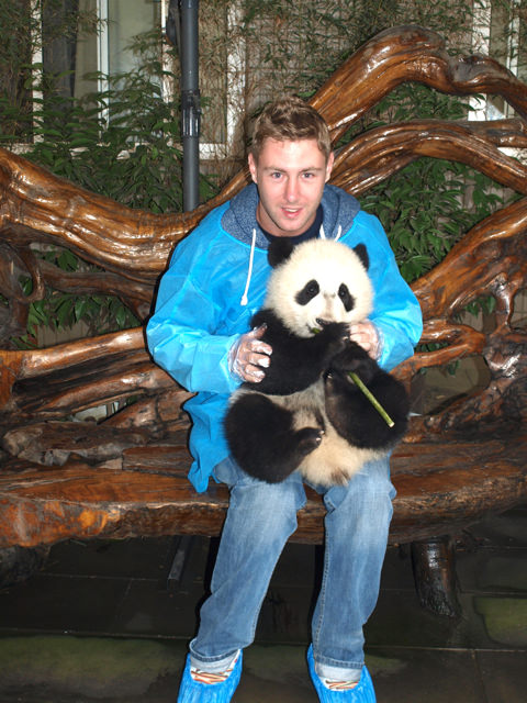Holding a panda in chengdu, China