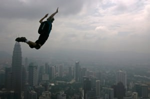 A base jumper jumps from the Kuala Lumpur Tower.