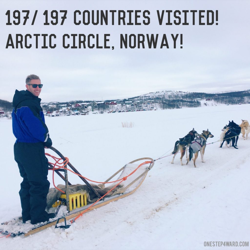 Husky riding across the Arctic Circle